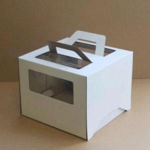 Škatla za torto z oknom, z ročaji 260x260x200 mm mikro valovit karton bela
